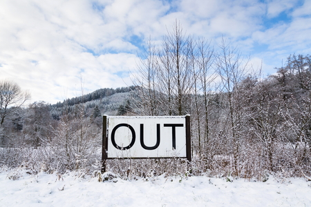 Out sign in snowy landscape, New Years Resolutions, self-improvement concept, lifestyle change, mind-body improvement, Foto de archivo