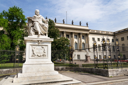 Wilhelm von Humboldt statue outside Humboldt University from 1883 by Martin Paul Otto, Berlin, Germany, sunny day Editorial