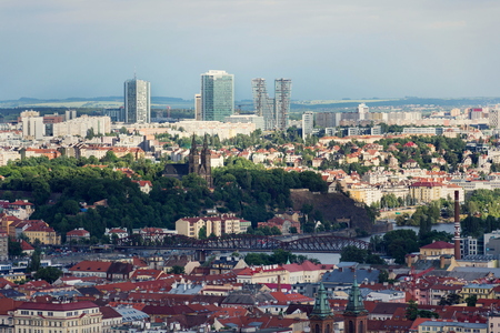 Panoramic view of historic fort Vysehrad with Basilica of St. Peter and St. Paul, Pankrac district in background, Prague tallest buildings City Tower, City Empiria and V Tower, Prague, Czech Republic
