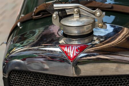 SAALBACH-HINTERGLEMM, AUSTRIA - JUNE 21 2018: Vintage Alvis oldsmobile veteran car standing on street on June 21, 2018 in Saalbach-Hinterglemm, Austria.