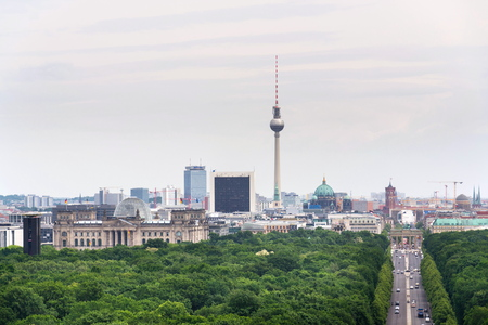 Berlin summer skyline aerial view of  Brandenburger Tor - Brandeburg gate and television tower Fernsehturm with cars passing crossroad under Victory Column in Tiergarten, Berlin, Germany