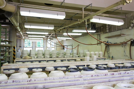Traditional ceramics pottery on production line in factory Stock Photo