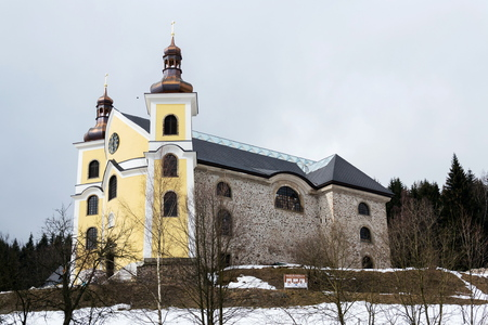 Church of Assumption with glass roof in snowy mountains country, Neratov, Orlicke hory, Eagle Mountains, Czech republic
