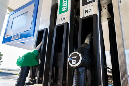 New fuel labeling at petrol station pumps with new EU labels, sunny day Stock Photo