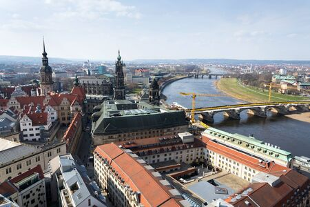 Aerial view of Dresden cathedral of the Holy Trinity with Augustus bridge over Elbe in Dresden, Germany, sunny spring day
