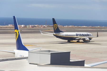 GRANADILLA DE ABONA, SPAIN - JULY 13 2019: Ryanair Irish low-cost airline Boeing 737 preparing for flight on airport runway on July 13, 2019 in Granadilla de Abona, Spain. Editorial