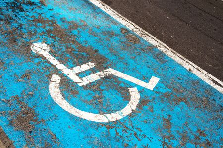Handicap parking sign painted on road on parking space for disabled or handicapped people in parking lot Banco de Imagens