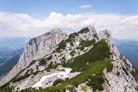 Unrecognizable people on top of the Grosser Donnerkogel Mountain in Alps, Banco de Imagens