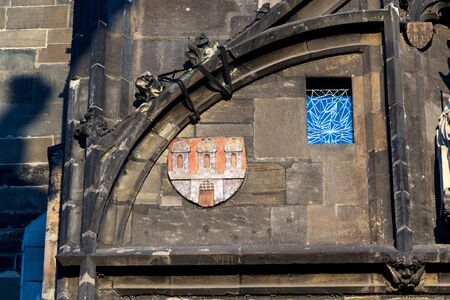 Coat of arms on the Old Town Bridge Tower guarding end of the Charles Bridge and entrance to Old Town of Prague, Czech Republic, sunny summer morning Banque d'images