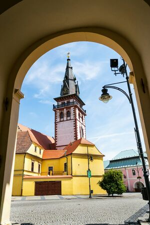 Sightseeing tower of the late gothic decanal Church of the Assumption of the Virgin Mary in Chomutov, Usti nad Labem region, Krusne hory, Ore Mountains, Czech Republic, sunny summer day, clear blue sk 스톡 콘텐츠