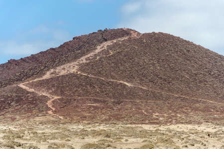 Montana Roja mountain on Tenerife coast near El Medano, Canary Islands, Spain, sunny summer day Standard-Bild