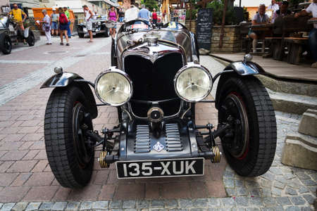 SAALBACH-HINTERGLEMM, AUSTRIA - JUNE 21 2018: People looking at vintage veteran car on June 21, 2018 in Saalbach-Hinterglemm, Austria.