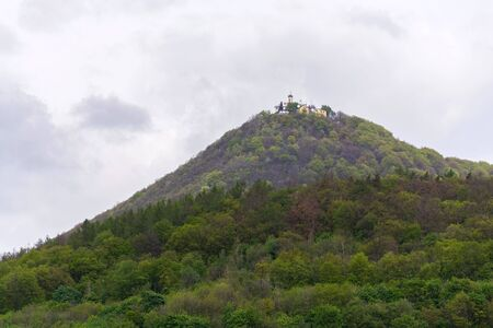 Green mixed forest on Milesovka, highest mountain of Ceske stredohori with lookout tower and meteorological station and observatory, Czech Republic 版權商用圖片