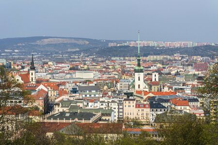 Aerial view of Brno with Church of St. James and Lisen panel housing estate in background, Moravia, Czech Republic, sunny day Stock Photo