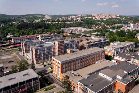 Traditional Zlin red brick buildings exterior, former shoe factory, Moravia, Czech Republic, sunny summer day, aerial view Editorial