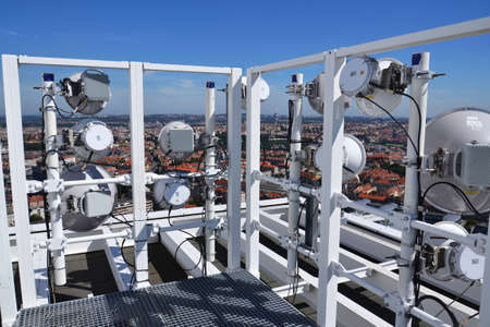 Construction for 5G broadband cellular network transmitters, telecommunication tower, wireless communication concept, clear blue sky background with copy space Imagens