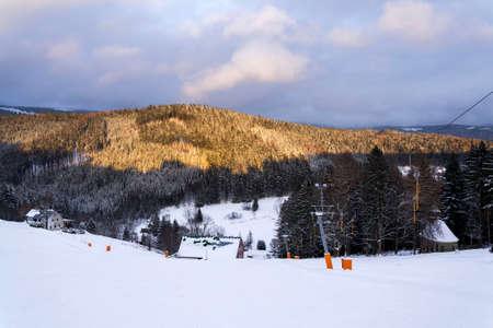 Stopped t-bar surface lift on abandoned empty ski slope, end of ski season and quarantine concept, Krkonose mountains, Czech Republic