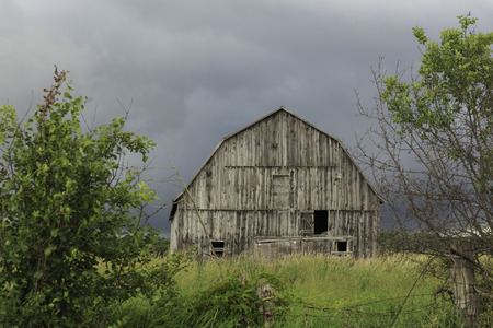 Abandoned wooden barn photo