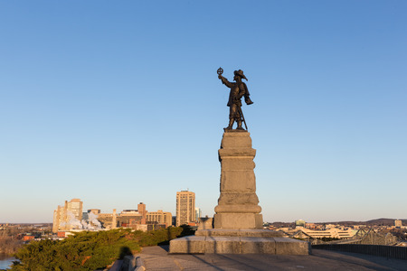 jacques: Statue of Jacques Cartier against a blue sky in spring