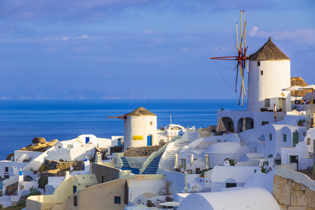 cyclades: Beautiful cycladic village Oia, windmills, Santorini island, Cyclades, Greece Editorial