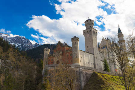 neuschwanstein: Neuschwanstein castle during early spring with mountains background, Southern Bavaria, Germany Stock Photo