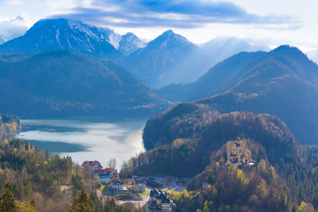 View from Neuschwanstein castle with Hohenschwangau castle, Alspee and Alps in the background, Southern Bavaria, Germany Stock Photo