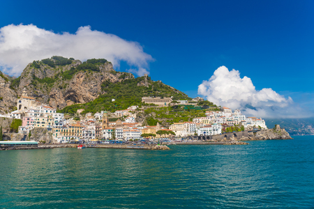 Beautiful town of Amalfi,front view with sea and boats in foreground, Amalfi coast, Campania, Italy