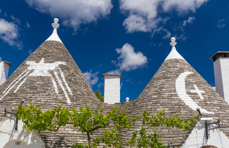 Detail of roofs and signs of the trulli houses, Alberobello town, Apulia region, Southern Italy