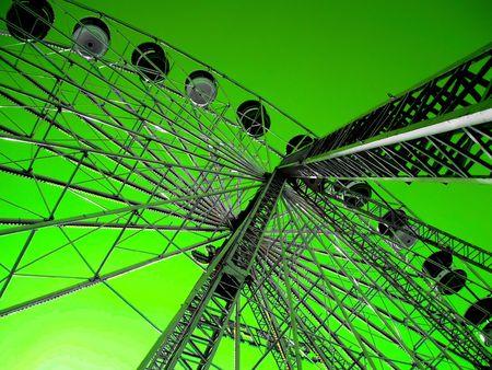 giant wheel on funfair, against green sky