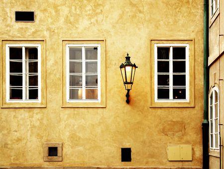 Three windows and a street lamp