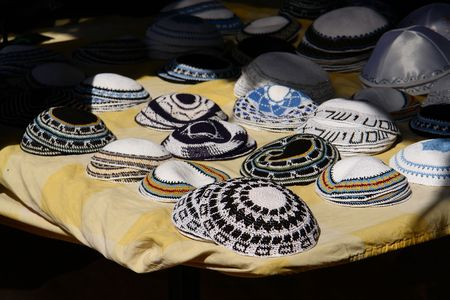 Jewish caps on sale on the Bedouin market of Ber-Sheba, Israel Stock Photo