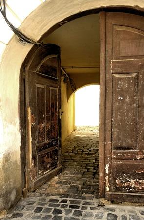 backlit entrance, wooden doors