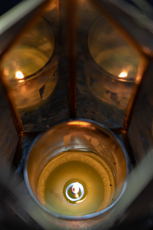 One candle with reflection