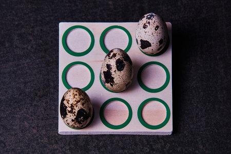 three quail eggs in tic-tac-toe game