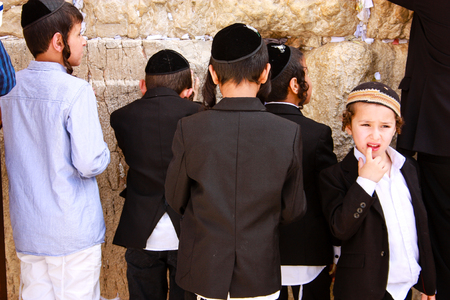 Unknown people praying on the wall of Jerusalem Israel Editorial