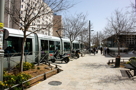 View of the tramway of Jerusalem and unknowns at Yafo street noon