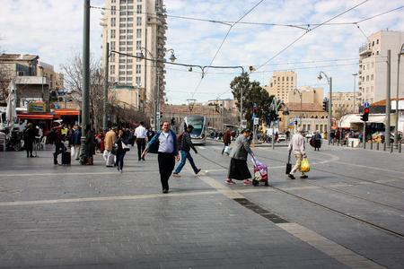 Jerusalem Israel March 4-2018 View of the tramway of Jerusalem and unknowns at Yafo street noon Reklamní fotografie - 97262172