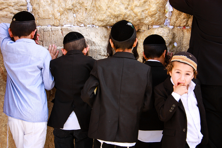 Jerusalem Israel March 6-2018 Unknown people praying at the western wall at the old city of Jerusalem morning Editorial