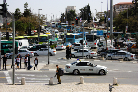 Unknown people walking in Yafo street near the central bus station in Jerusalem Israel March 4-2018 noon