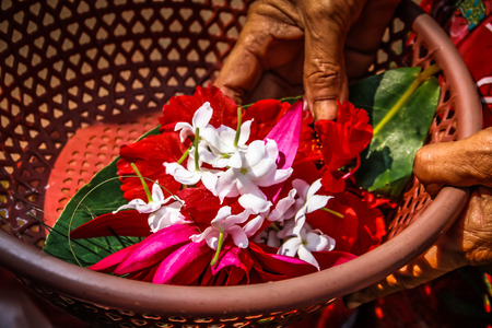 Unknowns people selling flowers on the Ganapati temple Gokarna Karnataka India November 22, 2017 morning