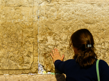 Jerusalem Israel April 16, 2018 Unknown woman praying front the Western Wall at the old city of Jerusalem on afternoon Editorial