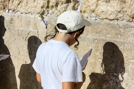 Jerusalem Israel May 14, 2018 Unknowns kids praying front the Western wall in the old city of Jerusalem in the evening Editorial