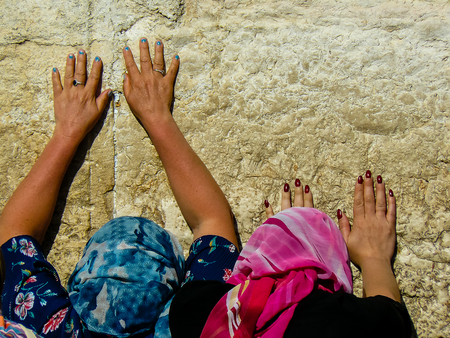 Jerusalem Israel May 14, 2018 Unknowns women praying front the Western wall in the old city of Jerusalem in the evening Editorial