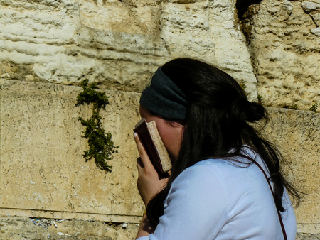 Jerusalem Israel May 14, 2018 Unknowns women praying front the Western wall in the old city of Jerusalem in the evening Publikacyjne