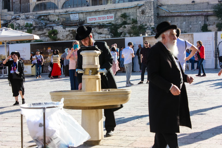 Jerusalem Israel May 14, 2018 unknown religious people in front of the public fountain on the Western Wall Square in Jerusalem