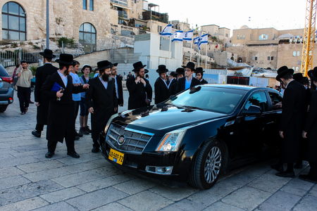 Jerusalem Israel May 14, 2018 unknown religious people accompanying the Chief Rabbi got his car from the Western Wall Square in Jerusalem in the late afternoon