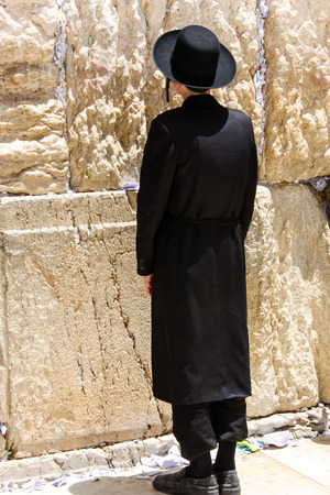 Jerusalem Israel May 21, 2018 View of an unknown religious Orthodox Jew praying in front of the western wall of the old city of Jerusalem