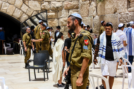 Jerusalem Israel May 21, 2018 View of Israeli soldiers standing front the Western wall in the old city of Jerusalem in the afternoon