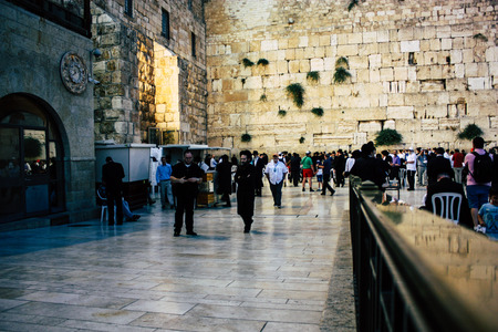 Jerusalem Israel June 22, 2018 View of unknowns people praying front the Western Wall at the old city of Jerusalem in the evening