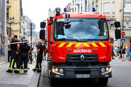 Reims France July 03, 2018 View of a French fire truck and fireman standing in the street of Reims in the afternoon 에디토리얼